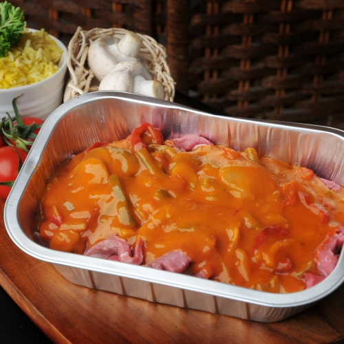 Strips of tender lean beef in a creamy sauce with garlic,peppers,mushrooms and onions.